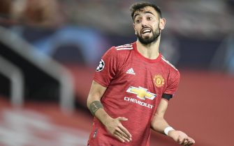 epa08840020 Bruno Fernandes of Manchester United reaccts during the UEFA Champions League group H soccer match between Manchester United and Istanbul Basaksehir in Manchester, Britain, 24 November 2020.  EPA/Peter Powell