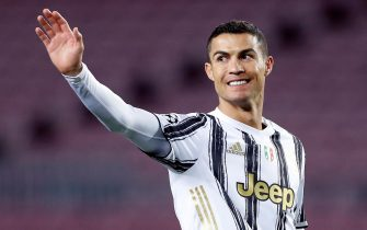 epa08871291 Juventus' striker Cristiano Ronaldo celebrates after scoring the 0-1 during the UEFA Champions League group G between FC Barcelona and Juventus at Camp Nou stadium in Barcelona, Catalonia, Spain, 08 December 2020.  EPA/Alberto Estevez