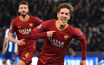 AS Roma Italian midfielder Nicolo Zaniolo celebrates after opening the scoring during the UEFA Champions League round of 16, first leg football match AS Roma vs FC Porto on February 12, 2019 at the Olympic stadium in Rome. (Photo by Andreas SOLARO / AFP)        (Photo credit should read ANDREAS SOLARO/AFP/Getty Images)