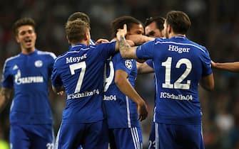 epa04656843 Schalke's Leroy Sane (c) and team mates celebrate a goal during the UEFA Champions League Round of 16 second leg soccer match at Santiago Bernabéu Stadium in Madrid, Spain, 10 March 2015.  EPA/INA FASSBENDER