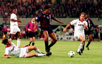 Ajax's hero Patrick Kluivert hits home the winner with the Milan defence lost  (Photo by Neal Simpson/EMPICS via Getty Images)