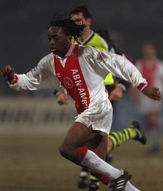 19 Mar 1996:  Kiki Musampa of Ajax on the ball during the Champions League game against Borussia Dortmund.