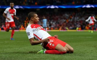 epa05807424 AS Monaco's Kylian Mbappe celebrates after scoring the 2-1 lead during the UEFA Champions League round of 16 first leg match between Manchester City and AS Monaco at the Etihad stadium in Manchester, Britain, 21 February 2017.  EPA/NIGEL RODDIS