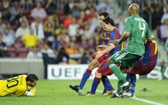 Panathinaikos goalkeeper Alexandros Tzorvas (L) grabs the ball after Barcelona's Argentinian forward Lionel Messi (3R) missed a penalty during the Champions League football match between Barcelona and Panathinaikos at Camp Nou stadium in Barcelona on September 14, 2010. AFP PHOTO / PIERRE-PHILIPPE MARCOU        (Photo credit should read PIERRE-PHILIPPE MARCOU/AFP via Getty Images)