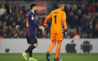 Enric Masip of Real Valladolid and Lionel Messi of FC Barcelona during the match between FC Barcelona vs Real Valladolid of La Liga, date 24, 2018-2019 season. Camp Nou Stadium. Barcelona, Spain - 16 FEB 2019.