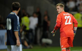 FRANKFURT AM MAIN, GERMANY - AUGUST 15:  Marc-Andre ter-Stegen of Germany looks over to Lionel Messi of Argentina during the international friendly match between Germany and Argentina and Commerzbank-Arena on August 15, 2012 in Frankfurt am Main, Germany.  (Photo by Dennis Grombkowski/Bongarts/Getty Images)