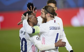 Sergio Ramos of Real Madrid celebrates with his teammate Vinicius Jr after scoring the 2-0  during the Champions League match, round of 16, between Real Madrid and Atalanta played at Alfredo Di Stefano Stadium on March 16, 2020 in Madrid, Spain. (Photo by Ruben Albarran / PRESSINPHOTO)