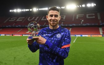 SEVILLE, SPAIN - APRIL 07: Jorginho of Chelsea poses for a photo with the Player of the Match award following the UEFA Champions League Quarter Final match between FC Porto and Chelsea FC at Estadio Ramon Sanchez Pizjuan on April 07, 2021 in Seville, Spain. Sporting stadiums around Spain remain under strict restrictions due to the Coronavirus Pandemic as Government social distancing laws prohibit fans inside venues resulting in games being played behind closed doors. (Photo by Denis Doyle - UEFA/UEFA via Getty Images)