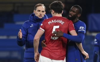 epa09043263 Chelsea's head coach Thomas Tuchel (L), Manchester United's Harry Maguire (C) and Chelsea's Antonio Rudiger (R) react after the English Premier League soccer match between Chelsea FC and Manchester United in London, Britain, 28 February 2021.  EPA/Andy Rain / POOL EDITORIAL USE ONLY. No use with unauthorized audio, video, data, fixture lists, club/league logos or 'live' services. Online in-match use limited to 120 images, no video emulation. No use in betting, games or single club/league/player publications.