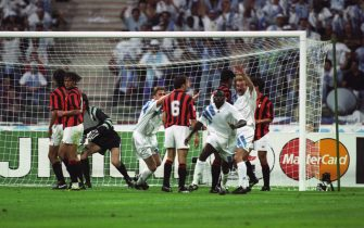 Marseille's Basile Boli (front) turns away in celebrate having scored the only goal of the game. Teammates Alen Boksic (4th left) and Rudi Voller (second right) celebrate with him as AC Milan players look dejected. They are (l-r) Paolo Maldini, Gianluigi Lentini, Sebastiano Rossi (goalkeeper), Franco Baresi, Frank Rijkaard and Demetrio Albertini   (Photo by Neal Simpson - PA Images via Getty Images)