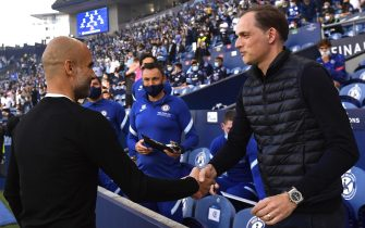 epa09235524 Manchester City manager Pep Guardiola (L) greets Chelsea manager Thomas Tuchel (R) prior to the UEFA Champions League final between Manchester City and Chelsea FC in Porto, Portugal, 29 May 2021.  EPA/Pierre-Philippe Marcou / POOL