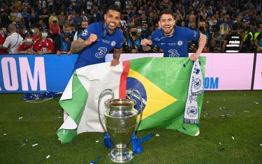 PORTO, PORTUGAL - MAY 29: Emerson Palmieri and Jorginho of Chelsea celebrates with the Champions League Trophy following their team's victory during the UEFA Champions League Final between Manchester City and Chelsea FC at Estadio do Dragao on May 29, 2021 in Porto, Portugal. (Photo by Darren Walsh/Chelsea FC via Getty Images)