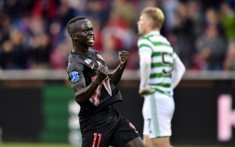 epa09374860 Awer Mabil of Midtjylland celebrates after scoring the 1-1 equalizer during the UEFA Champions League second qualifying round, second leg soccer match between FC Midtjylland and Celtic Glasgow in Herning, Denmark, 28 July 2021.  EPA/Bo Amstrup  DENMARK OUT
