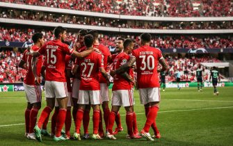 epa09419523 Benfica's Rafa (C) celebrates with team players after scoring a goal during the UEFA Champions League play-off first leg soccer match against PSV Eindhoven at Luz Stadium, in Lisbon, Portugal, 18 August 2021.  EPA/MARIO CRUZ