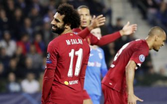 epa07944238 Mohamed Salah of Liverpool reacts during the UEFA Champions League Group E match between Genk and Liverpool FC in Genk, Belgium, 23 October 2019.  EPA/STEPHANIE LECOCQ