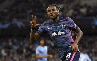 MANCHESTER, ENGLAND - SEPTEMBER 15: (BILD OUT) Christopher Nkunku of RB Leipzig celebrates after scoring his team's third goal during the UEFA Champions League group A match between Manchester City and RB Leipzig at Etihad Stadium on September 15, 2021 in Manchester, United Kingdom. (Photo by Vincent Mignott/DeFodi Images via Getty Images)