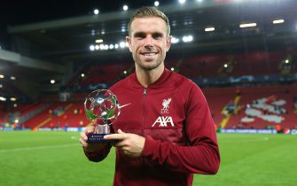LIVERPOOL, ENGLAND - SEPTEMBER 15: Jordan Henderson of Liverpool poses for a photo with the player of the match award following the UEFA Champions League group B match between Liverpool FC and AC Milan at Anfield on September 15, 2021 in Liverpool, England. (Photo by Alex Livesey - UEFA/UEFA via Getty Images)