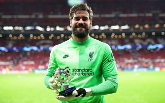 MADRID, SPAIN - OCTOBER 19: Alisson Becker of Liverpool poses for a photograph with their PlayStation Player of the Match award after the UEFA Champions League group B match between Atletico Madrid and Liverpool FC at Wanda Metropolitano on October 19, 2021 in Madrid, Spain. (Photo by Gonzalo Arroyo - UEFA/Getty Images)