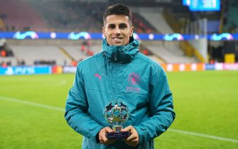 BRUGGE, BELGIUM - OCTOBER 19: Joao Cancelo of Manchester City poses with their PlayStation Player of the Match award after the UEFA Champions League group A match between Club Brugge KV and Manchester City at Jan Breydel Stadium on October 19, 2021 in Brugge, Belgium. (Photo by Matt McNulty - Manchester City/Manchester City FC via Getty Images)