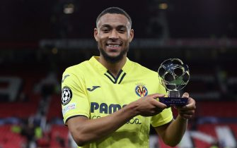 """MANCHESTER, ENGLAND - SEPTEMBER 29: Arnaut Danjuma of Villarreal CF poses for a photograph with their PlayStation """"Player of the Match"""" award after the UEFA Champions League group F match between Manchester United and Villarreal CF at Old Trafford on September 29, 2021 in Manchester, England. (Photo by Jan Kruger - UEFA/UEFA via Getty Images)"""