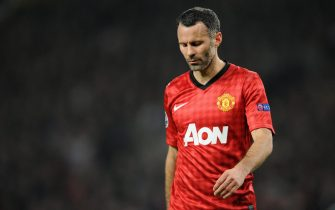 epa03611210 Manchester United's Ryan Giggs reacts during the UEFA Champions League match between Manchester United and Real Madrid at the Old Trafford Stadium in Manchester, Britain, 05 March 2013.  EPA/PETER POWELL