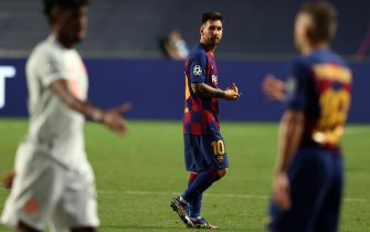 epa08604435 Lionel Messi of Barcelona reacts at the end of the UEFA Champions League quarter final match between Barcelona and Bayern Munich in Lisbon, Portugal, 14 August 2020.  EPA/Rafael Marchante / POOL