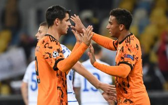 Juventus' Spanish forward Alvaro Morata celebrates with a teammate after the UEFA Champions League group G football match between FC Dynamo Kiev and Juventus at the Olympiyskiy stadium in Kiev on October 20, 2020. (Photo by Sergei SUPINSKY / AFP) (Photo by SERGEI SUPINSKY/AFP via Getty Images)