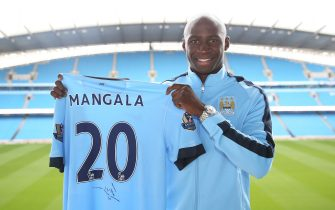 Barclays Premier League, Manchester City, Eliaquim Mangala signing, Etihad Stadium, Eliaquim Mangala stands in the Etihad Stadium with his new shirt   (Photo by Victoria Haydn/Manchester City FC via Getty Images)