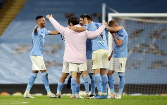 Manchester City's Riyad Mahrez (left) and his team-mates celebrate after the final whistle of the UEFA Champions League Semi Final second leg at the Etihad Stadium, Manchester. Picture date: Tuesday May 4, 2021.