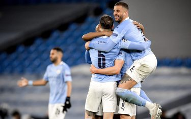 epa09178021 Manchester City's Kyle Walker (R) and his teammates celebrate after winning the UEFA Champions League semi final, second leg soccer match between Manchester City and Paris Saint-Germain in Manchester, Britain, 04 May 2021.  EPA/PETER POWELL
