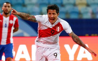 epa09319469 Gianluca Lapadula of Peru celebrates after scoring against Paraguay, during a match for the quarter-finals of the Copa America 2021 at the Pedro Ludovico Teixeira Olympic Stadium in Goiania, Brazil, 02 July 2021.  EPA/Alberto Valdes