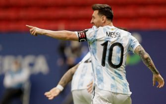 epa09327622 Argentina's Lionel Messi celebrates a goal scored by Lautaro Martinez of Argentina during the Copa America semifinal soccer match between Argentina and Colombia at Mane Garrincha stadium in Brasilia, Brazil, 06 July 2021.  EPA/Joedson Alves
