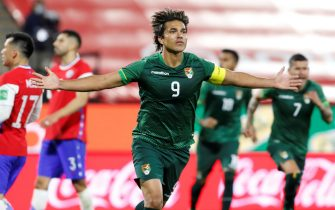 epa09256467 Bolivia's Marcelo Moreno Martins celebrates after scoring against Chile during a South American qualifying match between Chile and Bolivia for the Qatar 2022 World Cup, at the San Carlos de Apoquindo Stadium in Santiago, Chile, 08 June 2021.  EPA/Alberto Valdés /POOL