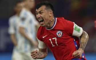 Chile's Gary Medel celebrates after assisting teammate Alexis Sanchez in his goal against Argentina during their South American qualification football match for the FIFA World Cup Qatar 2022 at the Estadio Unico Madre de Ciudades stadium in Santiago del Estero, Argentina, on June 3, 2021. (Photo by Agustin MARCARIAN / POOL / AFP) (Photo by AGUSTIN MARCARIAN/POOL/AFP via Getty Images)