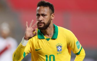 epa08742706 Neymar Jr of Brazil celebrates after scoring against Peru during the Qatar 2022 World Cup South American qualifiers match between Peru and Brazil at the National stadium in Lima, Peru, 13 October 2020.  EPA/Paolo Aguilar / POOL