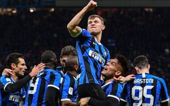 Inter Milan's Italian midfielder Nicolo Barella (Top) celebrates with Inter Milan's Argentinian forward Lautaro Martinez (2ndR) after scoring during the Italian Cup (Coppa Italia) round of 8 football match Inter Milan vs Fiorentina on January 29, 2020 at the San Siro stadium in Milan. (Photo by Miguel MEDINA / AFP) (Photo by MIGUEL MEDINA/AFP via Getty Images)