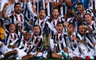 Juventus' players celebrate with the trophy after winning the Italy Cup's Final soccer match Juventus FC vs AC Milan at Olimpico stadium in Rome, Italy, 09 May 2018.