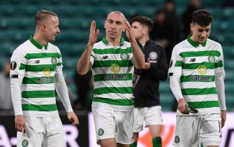 Celtic's Scottish midfielder Scott Brown (C), Celtic's Scottish forward Leigh Griffiths (L) and Celtic's Scottish midfielder Michael Johnston (R) celebrate on the pitch after the UEFA Europa League group E football match between Celtic and Rennes at Celtic Park stadium in Glasgow, Scotland on November 28, 2019. - Celtic won the game 3-1. (Photo by ANDY BUCHANAN / AFP) (Photo by ANDY BUCHANAN/AFP via Getty Images)