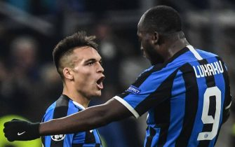 Inter Milan's Belgian forward Romelu Lukaku (R) celebrates with Inter Milan's Argentinian forward Lautaro Martinez after scoring an equalizer during the UEFA Champions League Group F football match Inter Milan vs Barcelona on December 10, 2019 at the San Siro stadium in Milan. (Photo by Miguel MEDINA / AFP) (Photo by MIGUEL MEDINA/AFP via Getty Images)
