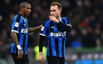 Inter Milan's English midfielder Ashley Young (L) and Inter Milan's Danish midfielder Christian Eriksen react at the end of the Italian Cup (Coppa Italia) round of 8 football match Inter Milan vs Fiorentina on January 29, 2020 at the San Siro stadium in Milan. (Photo by Miguel MEDINA / AFP) (Photo by MIGUEL MEDINA/AFP via Getty Images)