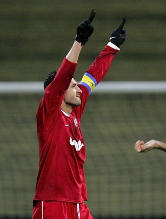 BUCHAREST, ROMANIA - NOVEMBER 29:  Claudiu Niculescu of Dinamo (L) celebrates after scoring a goal as Sergej Barbarez of Leverkusen looks down during the UEFA Cup Group B match between Dinamo Bucharest and Bayer Leverkusen at the Dinamo Stadium on November 29, 2006 in Bucharest, Romania.  (Photo by Vladimir Rys/Bongarts/Getty Images)
