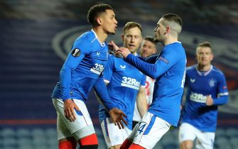 epa08860653 James Tavernier (L) of Rangers celebrates with teammate Ryan Kent (R) after scoring the 2-2 equalizer from the penalty spot during the UEFA Europa League group D soccer match between Glasgow Rangers and Standard Liege in Glasgow, Britain, 03 December 2020.  EPA/Jane Barlow / POOL
