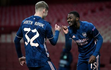 epa08860777 Arsenal's Emile Smith Rowe (L) celebrates with Arsenal's Ainsley Maitland-Niles (R) after scoring his team's fourth goal  during the UEFA Europa League group B soccer match between Arsenal and Rapid Vienna in London, Britain, 03 December 2020.  EPA/NEIL HALL