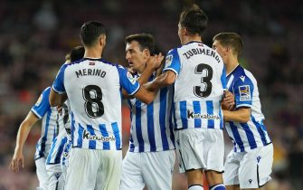 Mikel Oyarzabal of Real Sociedad celebrates his goal with his teammates during the La Liga match between FC Barcelona and Real Sociedad played at Camp Nou Stadium on August 15, 2021 in Barcelona, Spain. (Photo by PRESSINPHOTO)