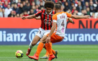"""Nice's French forward Lamine Diaby-Fadiga and Montpellier's Brazilian defender Vitorino Hilton fight for the ball during the French L1 football match between Nice and Montpellier on April 7, 2019 at the """"Allianz Riviera"""" stadium in Nice, southeastern France. (Photo by VALERY HACHE / AFP)        (Photo credit should read VALERY HACHE/AFP via Getty Images)"""