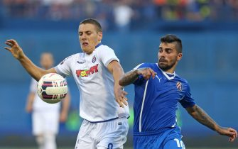 """Dinamo's Portuguese Paulo Ricardo Ribiero De Jesus Machado (R) vies with Hajduk Split's Nikola Vlasic during a football match in Zagreb, on July 12, 2015.A north-south antagonism, a duel between the prosperous capital and a poorer port city: as ever, the Croatian derby between age-old rivals Dinamo Zagreb and Hajduk Split promises high tension on October 2. These giants of Croatian football, who have only once since independence in 1991 let another club win the national championship, are known by local media as the """"eternal rivals"""". / AFP / STRINGER        (Photo credit should read STRINGER/AFP via Getty Images)"""