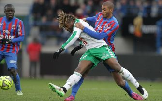 Saint-Etienne's midfielder Allan Saint-Maximin (L) vies for the ball with Caen's French midfielder Jordan Adeoti during the French L1 football match between Caen (SMC) and Saint-Etienne (ASSE) on February 1, 2015 at the Michel d'Ornano stadium in Caen, northwestern France. AFP PHOTO / CHARLY TRIBALLEAU        (Photo credit should read CHARLY TRIBALLEAU/AFP via Getty Images)