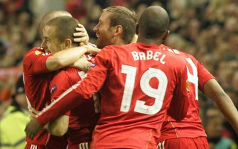 epa02339649 Liverpool's Joe Cole (L) celebrates his early goal against FC Steaua Bucharest with teammates during their UEFA Europa League soccer match at the Anfield Stadium in Liverpool, Britain 16 September 2010.  EPA/LINDSEY PARNABY