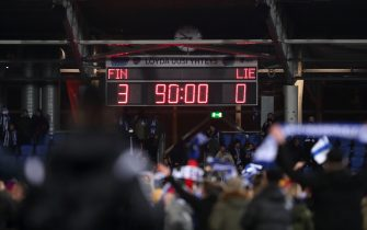 HELSINKI, FINLAND - NOVEMBER 15: Fans celebrate on the pitch as the Scoreboard showing the final score as 3-0 to Finland confirming qualification to Euro 2020 during the UEFA Euro 2020 Qualifier between Finland and Liechtenstein on November 15, 2019 in Helsinki, Finland. (Photo by James Williamson - AMA/Getty Images)