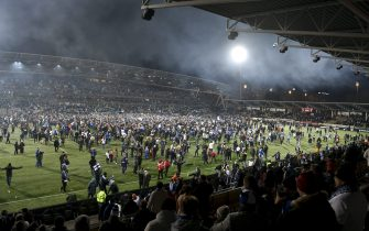 Fans join the players on the pitch to celebrate the victory after the UEFA Euro 2020 Group J qualification football match between Finland and Liechtenstein in Helsinki, Finland, on November 15, 2019. (Photo by Martti Kainulainen / Lehtikuva / AFP) / Finland OUT (Photo by MARTTI KAINULAINEN/Lehtikuva/AFP via Getty Images)